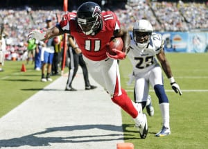 Atlanta Falcons wide receiver Julio Jones (11) hauls in a touchdown pass over San Diego Chargers cornerback Quentin Jammer during the first half of an NFL football game in San Diego, Sunday, Sept. 23, 2012. (AP Photo/Gregory Bull)