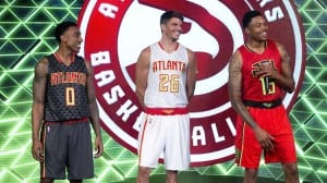 Atlanta Hawks players, from left, Jeff Teague, Kyle Korver and Kent Bazemore laugh as they model the team's new uniforms during an NBA basketball news conference, Wednesday, June 24, 2015, in Atlanta.  (AP Photo/John Bazemore)